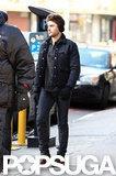Zac Efron filmed while wearing earmuffs in NYC.