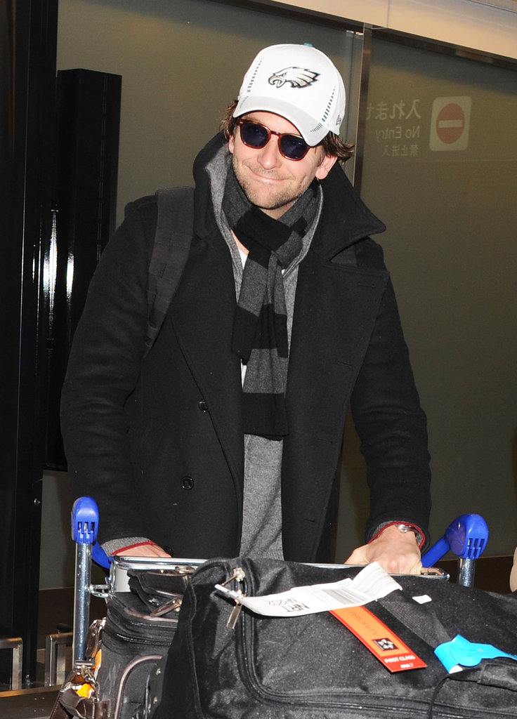 Bradley Cooper wore a Philadelphia Eagles hat as he touched down in Japan.