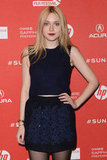 Upon closer inspection, Dakota revealed a little midriff in her Louis Vuitton look.