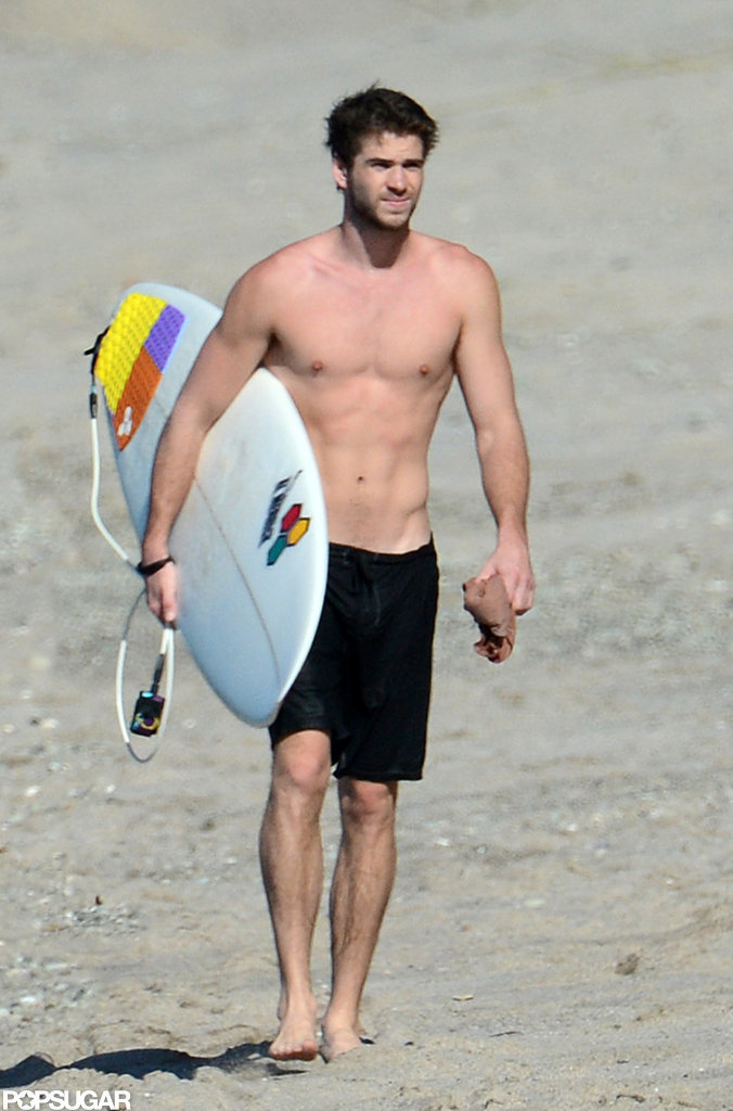 Liam Hemsworth went shirtless to go surfing in Costa Rica.