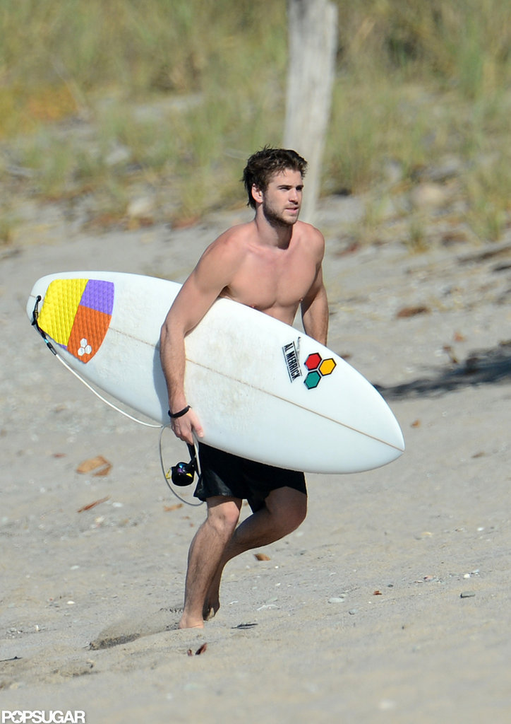 Liam Hemsworth walked on the beach shirtless.