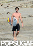 Liam Hemsworth showed off his shirtless body on the beach.