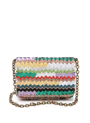 Santi's sequined bag ($205) will pair nicely with your Winter blacks now and with colorful floral dresses come Spring.
