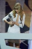 Taylor Swift smiled while accepting her award.