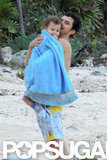 Orlando Bloom carried Flynn on the beach.