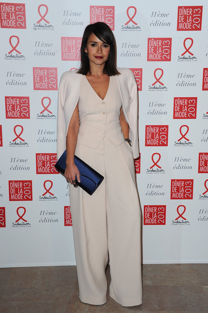 Miroslava Duma looked so chic in a cream-colored vest top, wide-leg pant, and cape Giorgio Armani combo. Her satin sapphire-hued envelope clutch supplied the subtle color pop this neutral Sidaction Gala look deserved.
