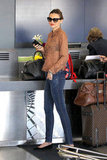 Miranda Kerr wore a sheer printed blouse at LAX Airport on Jan. 22. She was joined by husband Orlando Bloom and son Flynn.