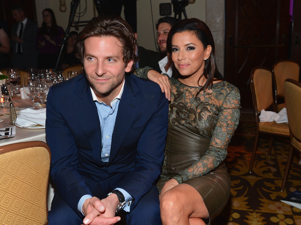 Eva Longoria cozied up to Bradley Cooper at the Friends Help Haiti Home Gala in January.