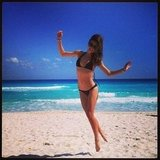 Miranda Kerr sported a tiny black bikini on the beach. Source: Instagram user mirandakerrverified