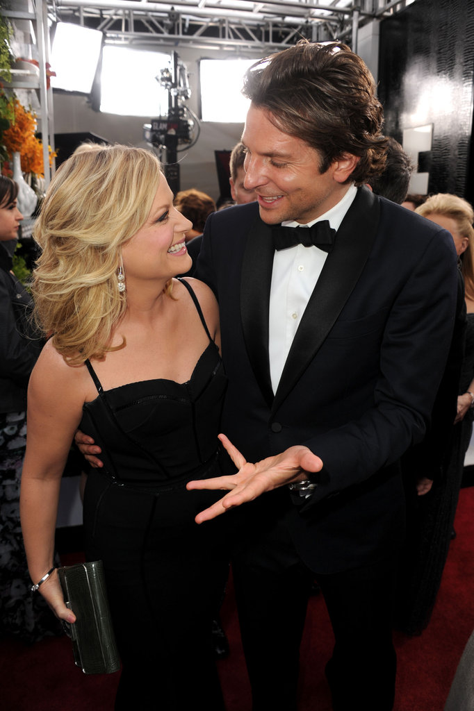 Amy Poehler and Bradley Cooper laughed it up on their way into the SAGs.