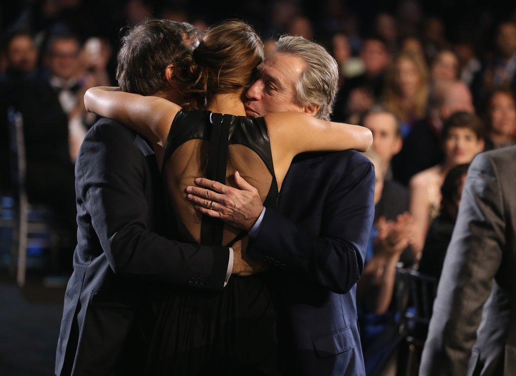Jennifer Lawrence got hugs from both sides from her director David O. Russell and costar Robert De Niro at the Critics' Choice Awards.