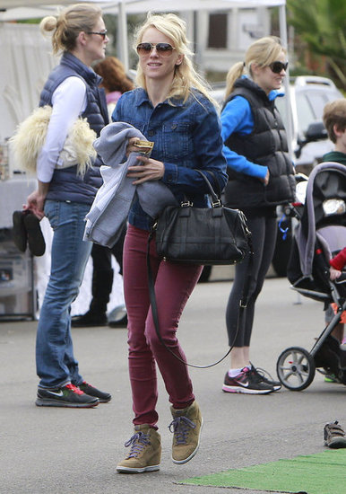 Naomi Watts wore burgundy jeans and a denim button-up Sunday at the farmers market in Brentwood.