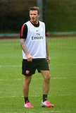 David Beckham trained with the Arsenal club on the soccer field.