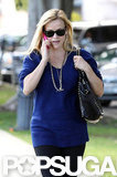 Reese Witherspoon wore a blue sweater.