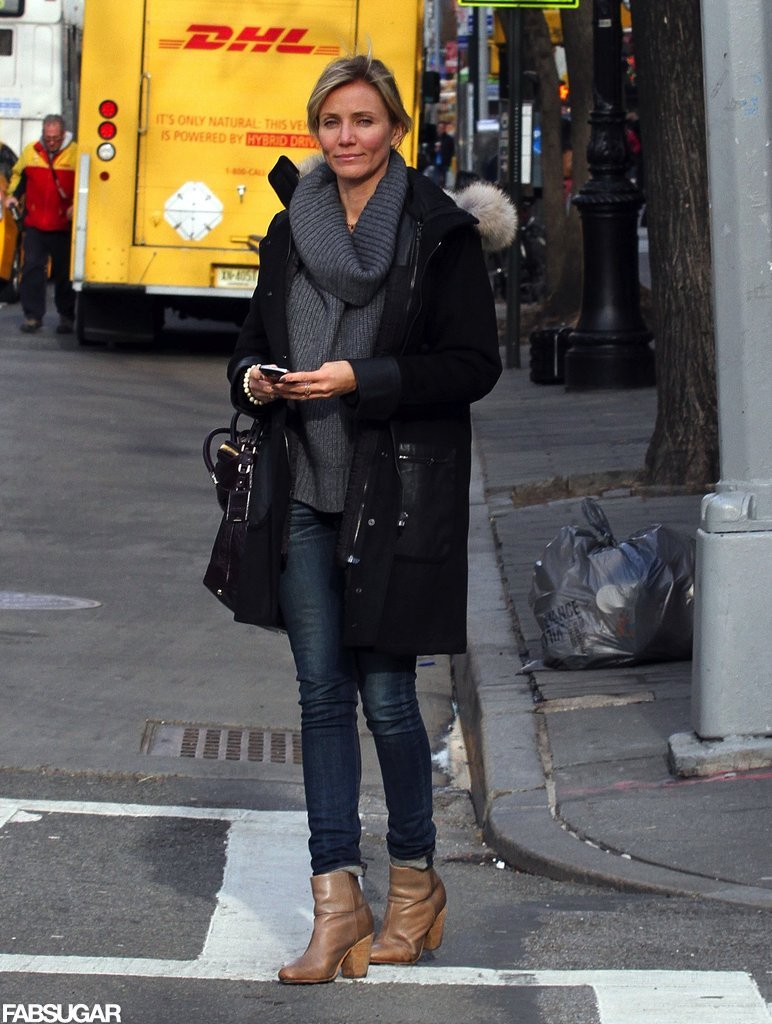 Cameron Diaz's gray ribbed cowl-neck sweater kept her warm and cool. She completed her NYC outfit with a black leather-accented coat, skinny jeans, and beige Rag & Bone booties.