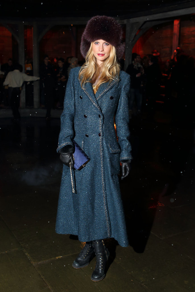 Poppy Delevingne's fur cossack, leather gloves, and long tweed trench coat were a sophisticated way to beat the chill.