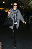 Leave it to Miranda Kerr to make layering look so darn polished. While at the airport in NYC, the model topped her A.L.C. leopard cardigan, black leather Helmut Lang pants, and Isabel Marant sneakers with a gray piped coat.