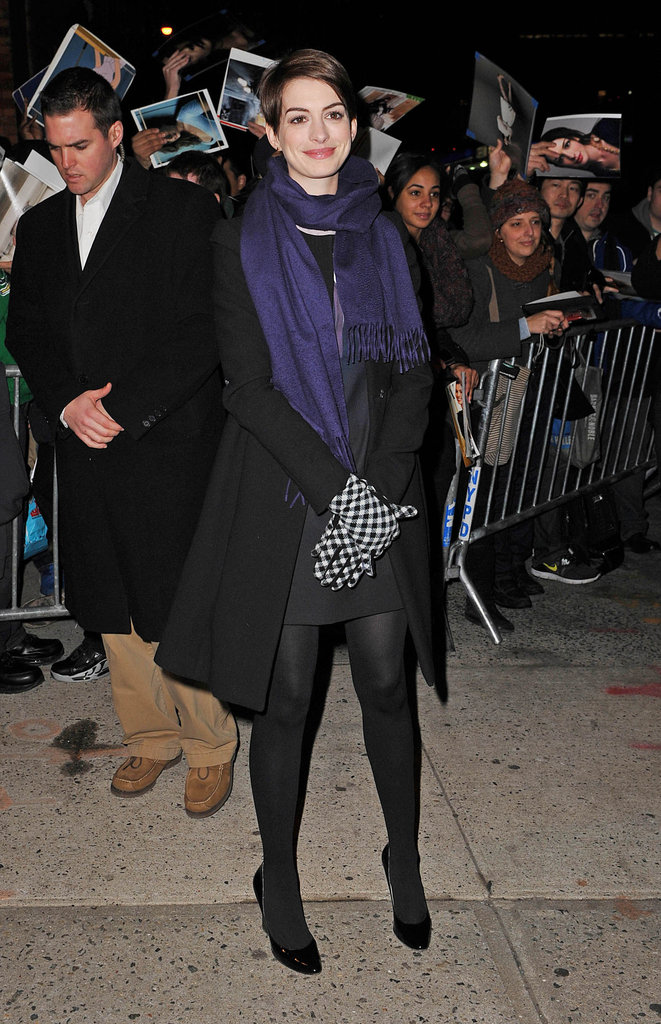 Anne Hathaway's Winter style was all about her checkered gloves and purple scarf.
