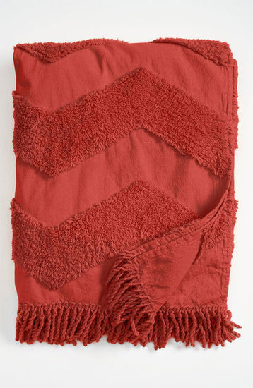 Using a red throw ($58) for a pop of color is a great addition to any room and the perfect item to cuddle with.