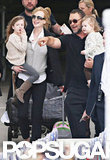 Russell Crowe greeted Nicole Kidman and her two daughters at an airport in Sydney.