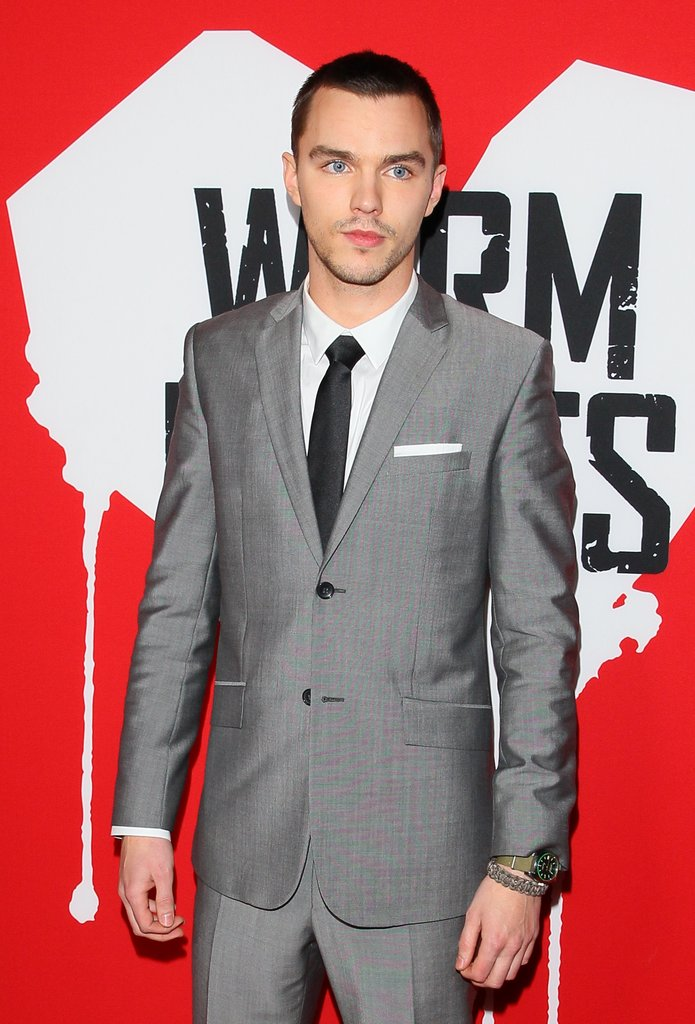 Nicholas Hoult wore a gray suit on the red carpet.