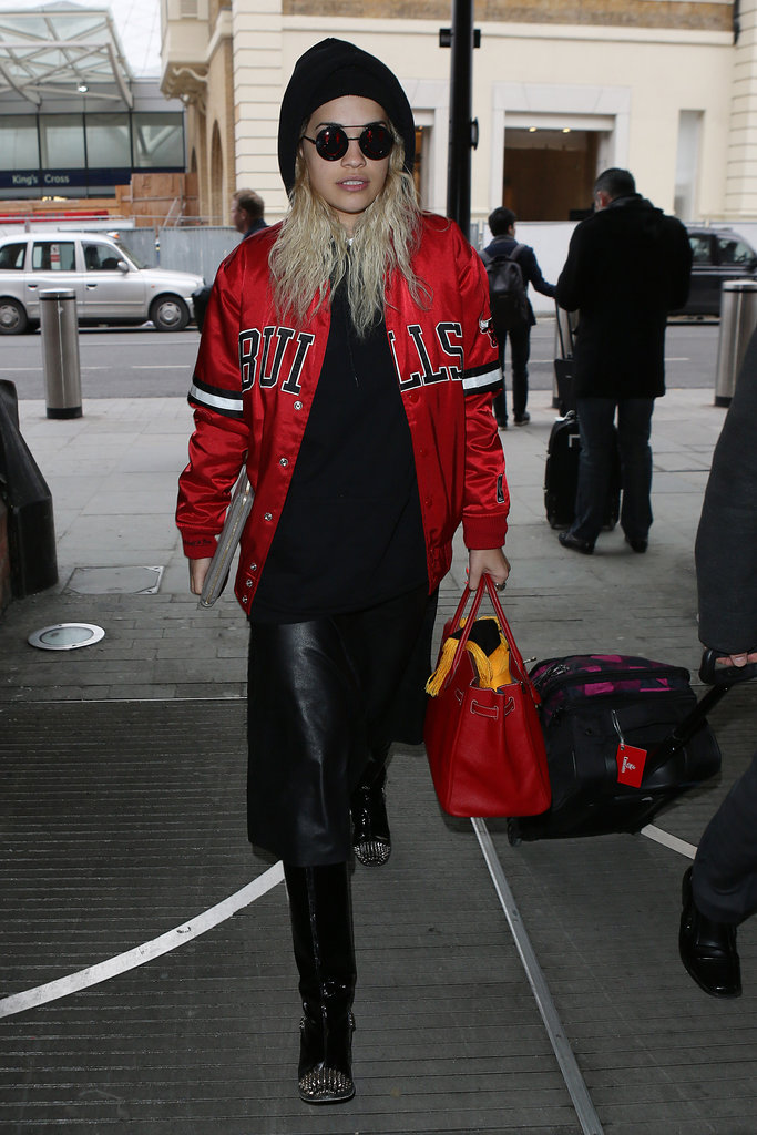 Rita Ora took her sporty Chicago Bulls jacket to cozy heights via a black knit beanie and studded boots.