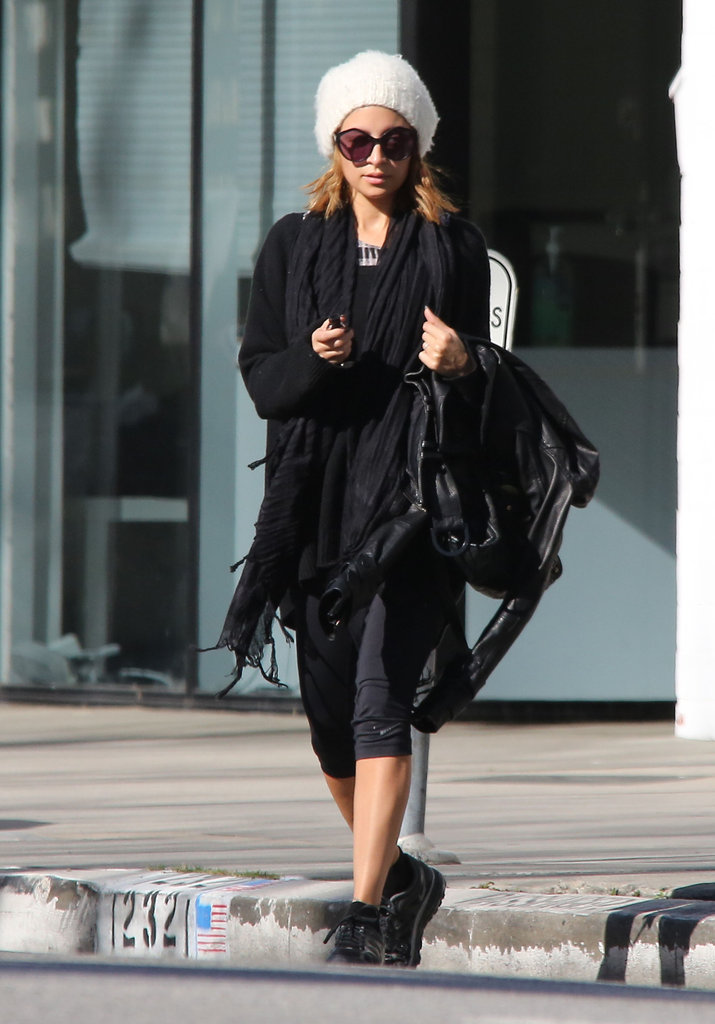 Nicole Richie kept her workout gear fashionable in a fuzzy white beanie.    Shop similar beanies below: 9879278