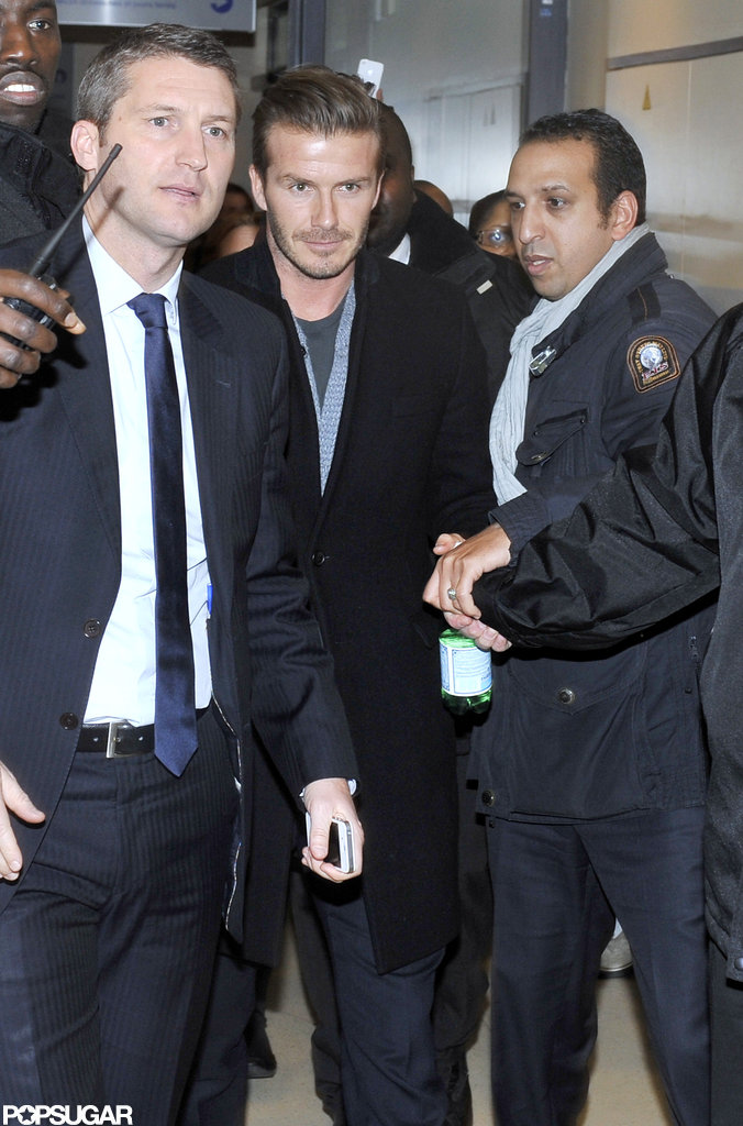 David Beckham was escorted out of a hospital in Paris.