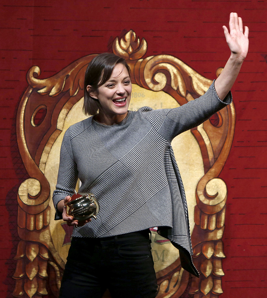 Marion Cotillard waved as she accepted her award at the Hasty Pudding Theatricals 2013 Woman of the Year award ceremony on Thursday.