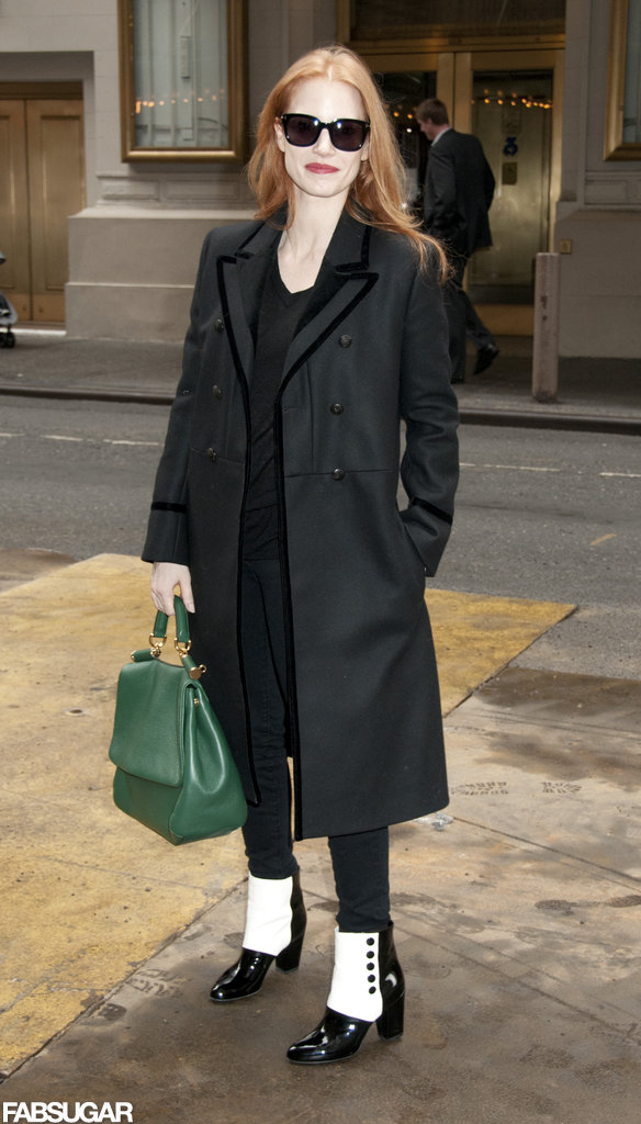 Jessica amped up her black basics with chic add-ons — a velvet trim military coat, patent black-and-white ankle boots, and an emerald Dolce & Gabbana tote — before heading into a matinee performance of The Heiress in NYC.