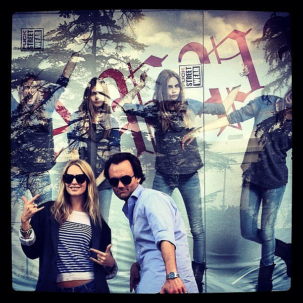 Poppy Delevingne posed in front of an ad featuring her sister, Cara. Source: Instagram user poppydelevingne