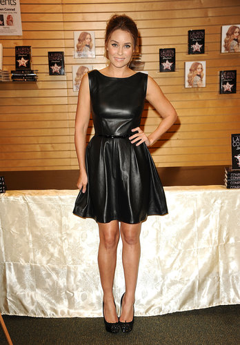 Lauren hopped on the leather dress train in a knee-length Johanna Johnson dress in 2012. Lesson from Lauren: a leather fit-and-flare is equal parts edgy and feminine.