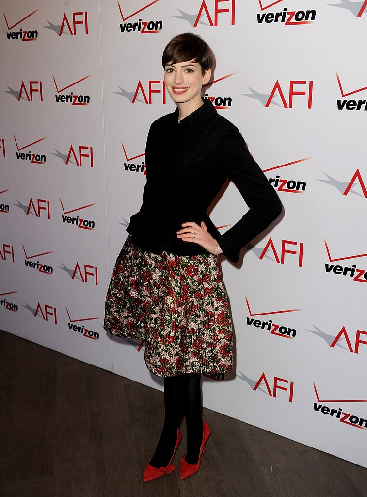 Anne Hathaway's floral skirt and red Isabel Marant pumps totally livened up her dark upper half at the 13th annual AFI Awards. Wear your favorite floral skirt with a black jacket and red pumps to get this look.