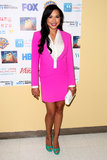 Naya Rivera may have been wearing a skirt suit at an event in Culver City, CA, but the neon-pink hue, and her green peep-toes, definitely got her noticed. To get noticed too, find a bold pink skirt suit, then finish off with contrasting green pumps.
