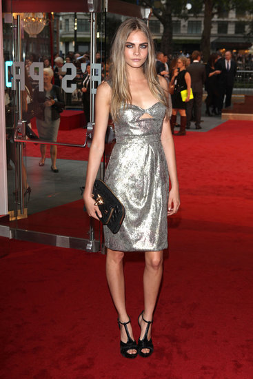 Cara Delevingne (yet again) showcased her love of Burberry by rocking a silver sequin cutout confection with black velvet t-strap sandals and a fox quilted clutch, all by the design house, at the world premiere of Anna Karenina in London.