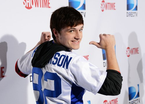 Josh Hutcherson made a show of his personalized football jersey before the celebrity bowl game on Saturday.
