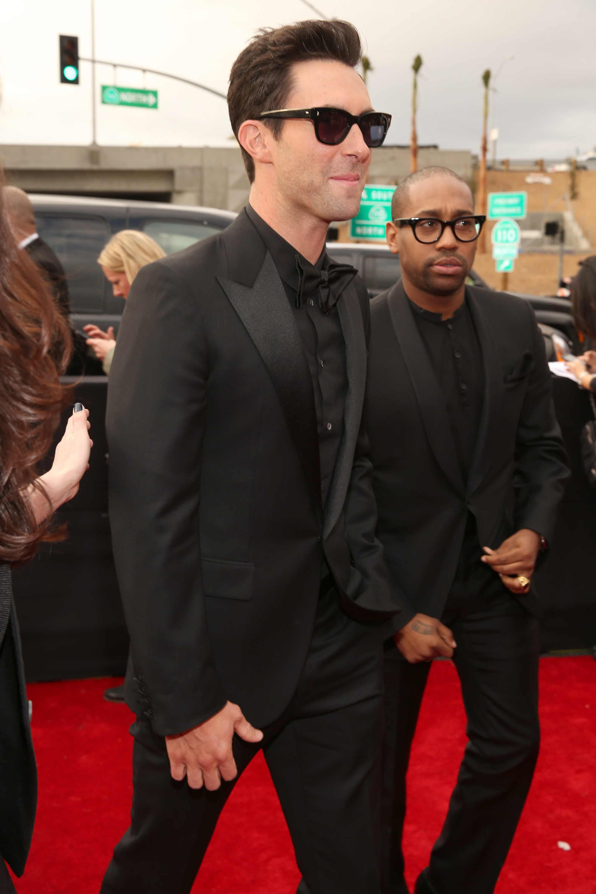 Adam Levine arrived at the Grammy Awards in an all-black suit.