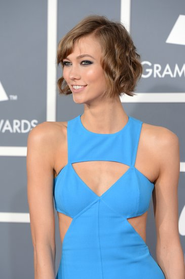 Karlie Kloss showed some skin with cutouts in her dress.
