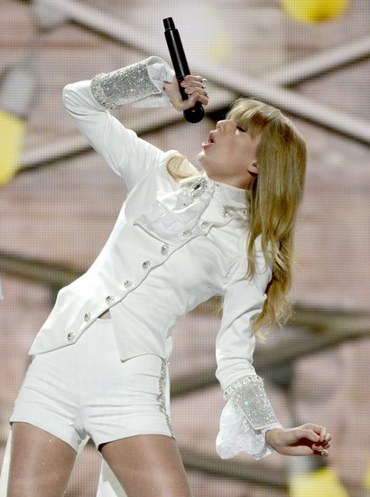 "Taylor Swift belted it out on stage when she opened the show with ""We Are Never Ever Getting Back Together."""