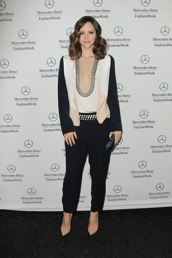Katharine McPhee looked polished in a plunging colorblock top and loose-fitting black trousers at Mercedes-Benz Fashion Week at Lincoln Center. Nude pumps and a navy clutch completed her look.