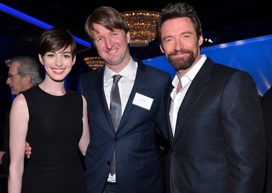 Anne Hathaway, Tom Hooper, and Hugh Jackman posed for pictures inside the special Oscars luncheon Monday.