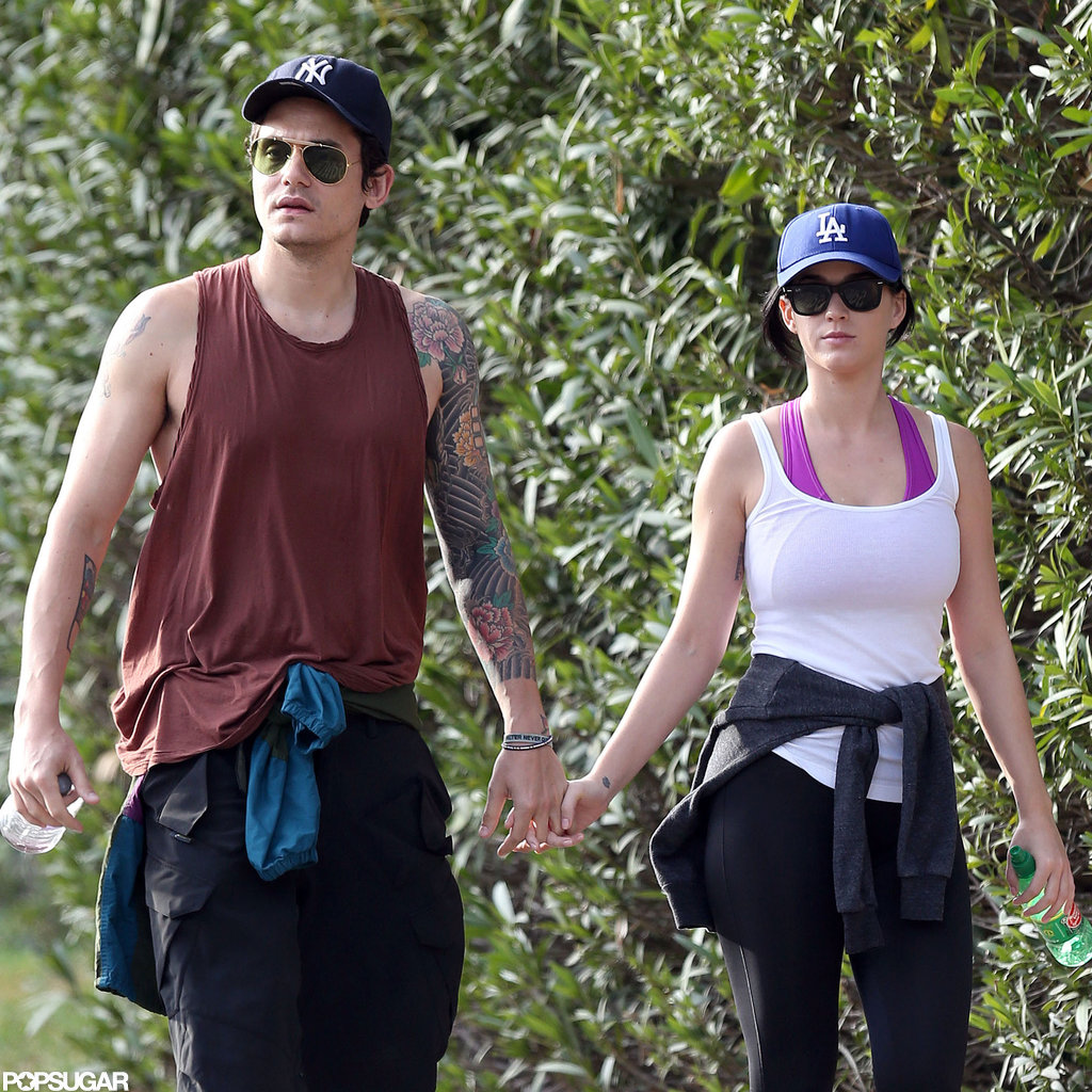 Katy Perry and John Mayer wore dueling baseball hats.
