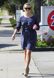 Reese Witherspoon wore a blue sun dress with brown booties for an LA outing.
