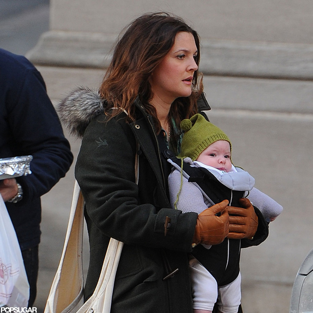 Drew Barrymore carried her daughter, Olive, in NYC.