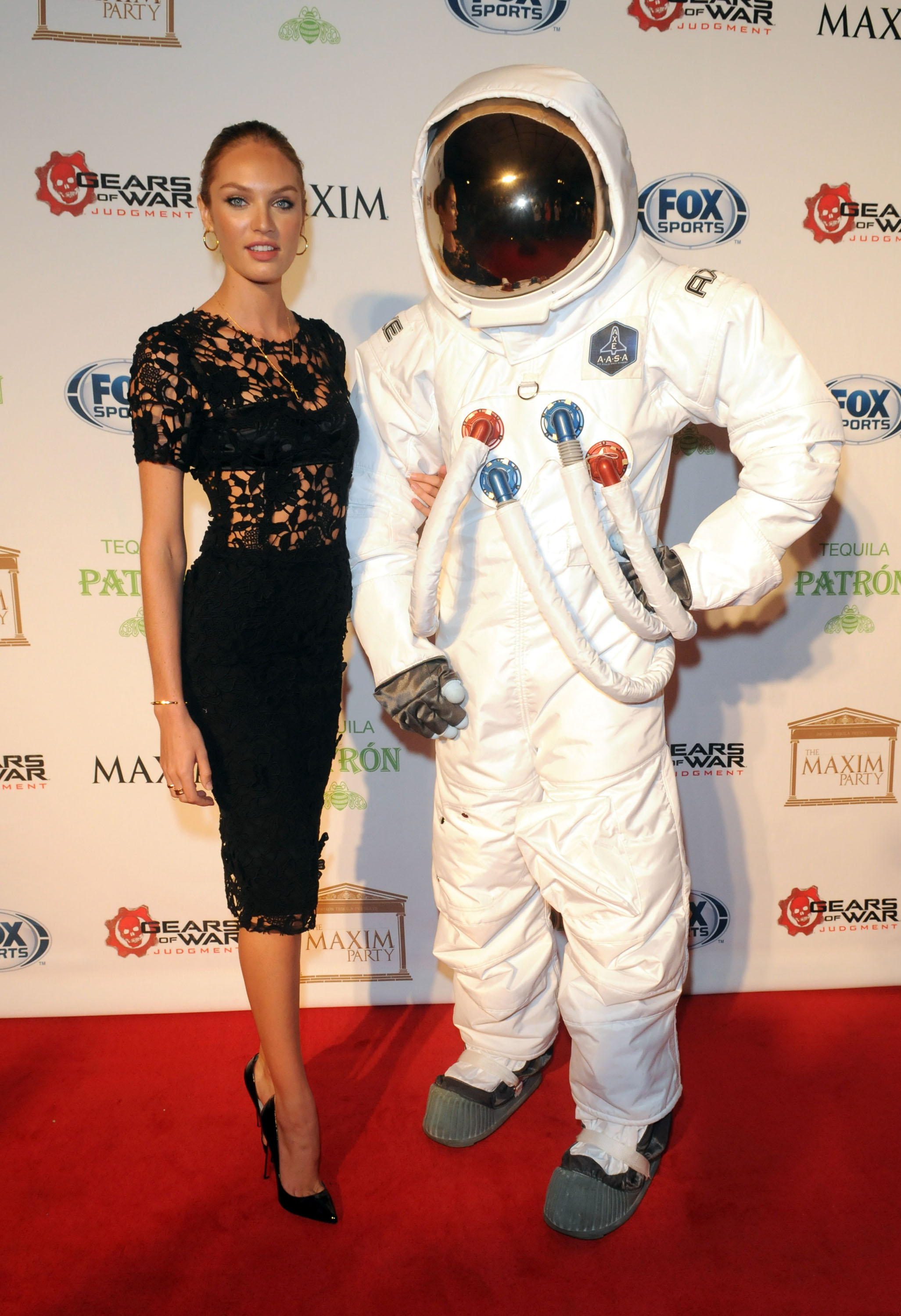 Candice, still with her moon man, changed from one sexy black outfit to another — this time with a lacy-bodice upgrade — at the Maxim Super Bowl party.