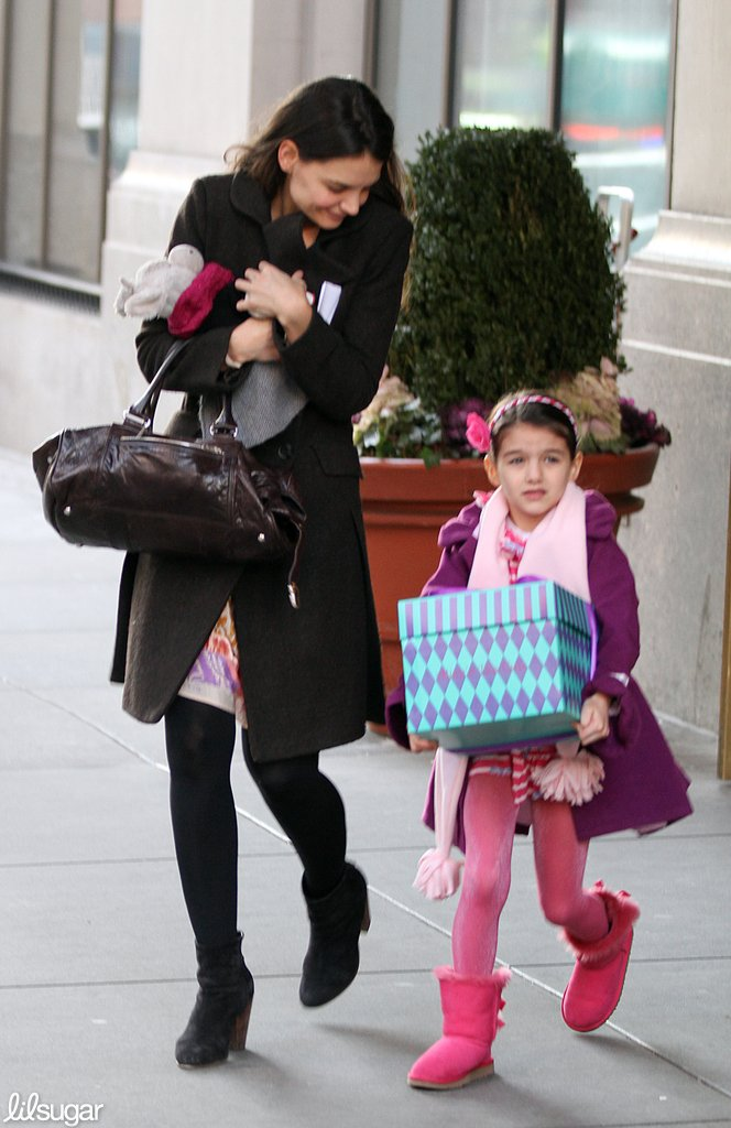 Katie Holmes and daughter Suri left their NYC apartment carrying presents.