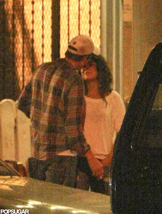 Ashton Kutcher snuck Mila Kunis a kiss after dinner in NYC in September 2012.