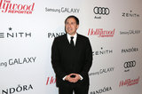 David O. Russell attended the event in a suit.