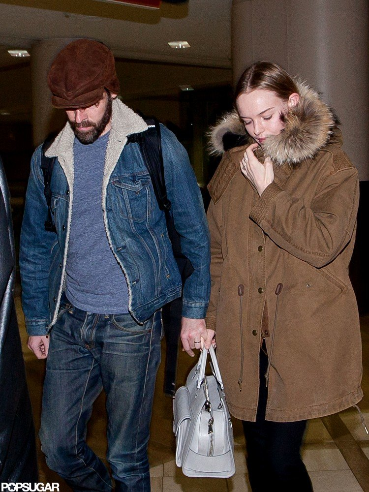 Kate Bosworth wore a brown jacket with a fur hood to touch down at LAX with fiancé Michael Polish.
