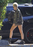 Miley Cyrus wore little else but a camouflage army jacket and combat boots while out visiting a friend in Studio City.